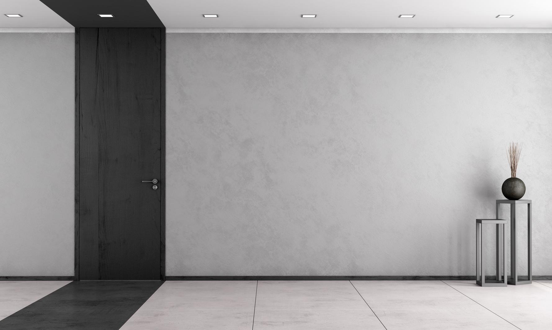 Minimalist living room with closed door